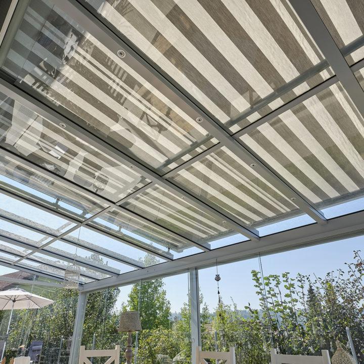 glasdach mit beschattungssystem integriert